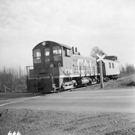 C.N. switcher #7218 and caboose on Lulu Island