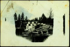 Lumber Pile and Cardboard Boxes