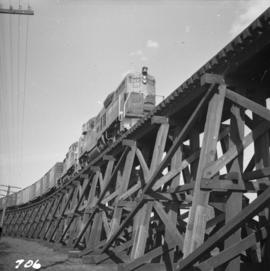 Great Northern Railway freight train travelling over a trestle bridge