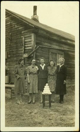 Hermina Taylor & Friends Stand Behind Cake