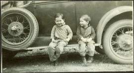 Young Alan and Fred Baxter sitting on car