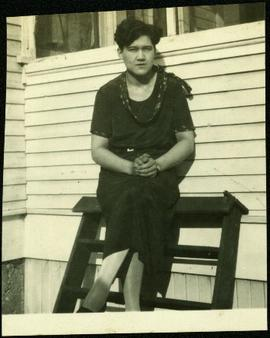 Violet Baxter Seated in Front of House
