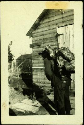 Man Carrying Carcass