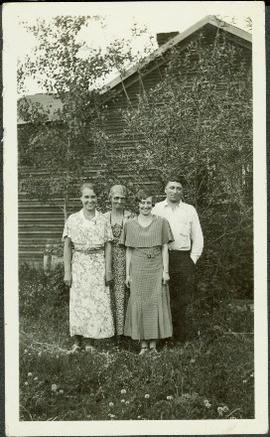 Bob Baxter with Mother and Sisters in Front of House