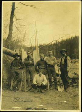 Six Men Standing with Oars & Poles