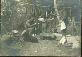 Crew Eating in Camp