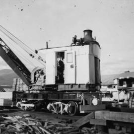 Steam crane in yard of Lions Gate Lumber Co.
