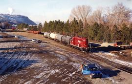 CP delivering tank cars at an interchange track