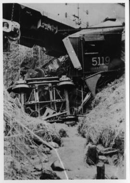 Derailment spanning creek with locomotive 5119