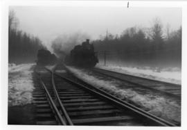 Two steam locomotives approaching