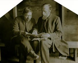 Archdeacon W.H. Collison giving reading lesson to unidentified man at Kincolith, BC