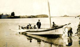 Bertha and W.E. Collison in boat with young daughters, leaving Metlakatla, BC for England