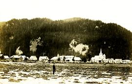 Archdeacon W.H. Collison standing on beach at Kincolith, BC