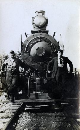 Railway workers on Pacific Great Eastern #3 locomotive