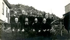 W.E. Collison posing with other clergy at Metlakatla, BC
