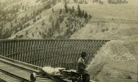 Sallus Creek railway trestle with Mr. Crysdale on velocipede