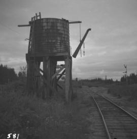 A water tower on rail line