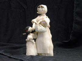 Corn husk figurines of woman and child