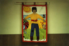 "Queen Charlotte City community hall tapestry ""Boy on Beach"""