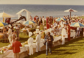 Overview of an outdoor seaside buffet in Nova Scotia attended by Campagnolo and Trudeau