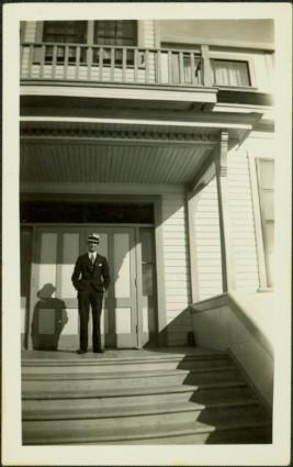 H.F. Glassey at Government Building in Atlin, BC