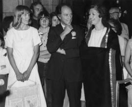 Iona Campagnolo wearing a button blanket with Pierre Trudeau and students at the House of Commons