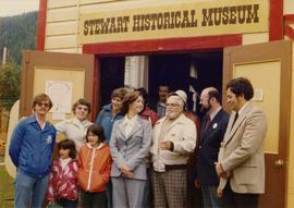 Iona Campagnolo with John C. Lundquist and others in front of the Stewart Historical Museum
