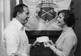 Iona Campagnolo presenting cheque to director of the Native Brotherhood of British Columbia