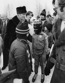 Iona Campagnolo and Pierre Trudeau talk with four unidentified children