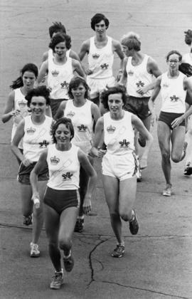 Youth track teams running and wearing Edmonton 1978 shirts