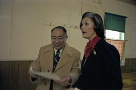 Iona Campagnolo examines a document with Earl Mah in the Prince Rupert Chinese Senior Centre