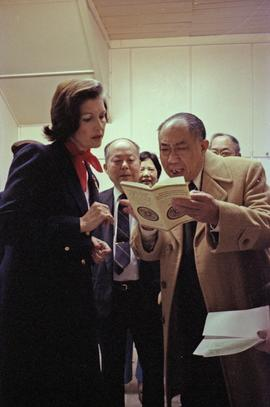 Iona Campagnolo and Earl Mah reading a chinese book