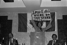 "Iona Campagnolo holding up a sign stating ""Spill it Iona Where do you stand? Hmmm . . . """