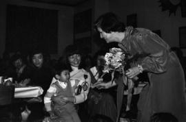 Iona Campagnolo hands flowers to Chinese-Canadian children at Chinese New Year event