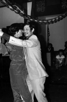 Iona Campagnolo dancing with an unidentified Chinese-Canadian man at Chinese New Year event