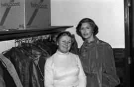 Iona Campagnolo poses with unidentified woman in coatroom