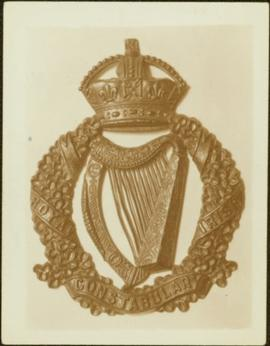 Closeup of an Royal Irish Constabulary helmet badge