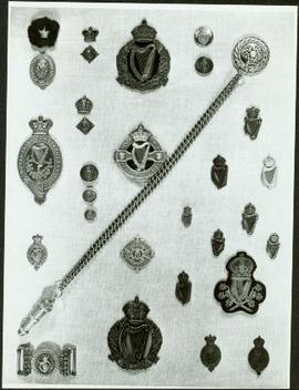 Closeup of Royal Irish Constabulary badges, buckle and whistle chain