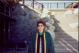 Bridget Moran Wearing UNBC Regalia in Courtyard