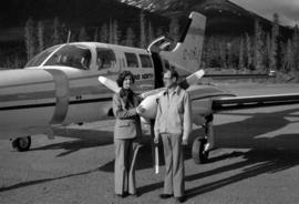Iona Campagnolo with Brian Pewsey in front of Trans North Plane in Cassiar