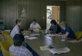 Iona Campagnolo and men in meeting room at fish cannery