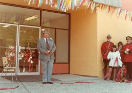 Herbert Maitland with cut ribbon at opening of Haisla Recreation Centre in Kitamaat Village