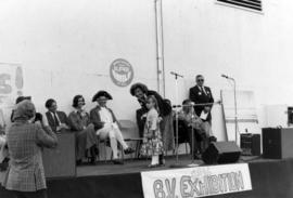 Deputy Premier Grace McCarthy and young girl on stage with Iona Campagnolo and others in backgrou...