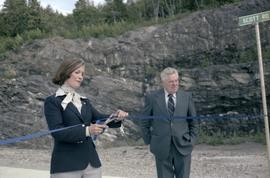 Iona Campagnolo cutting ribbon and Joe Scott at opening ceremony for Scott Road Highway opening i...
