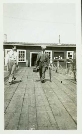 Dr. Armstrong and Nurse Hall leaving a fish cannery