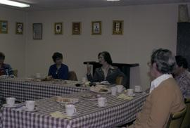 Iona Campagnolo speaking at a table with Masset Liberals at a meeting at the Lions Club in Masset