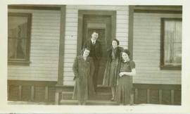 Dr. and Mrs. Austen standing with two unidentified women