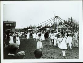 Young Girls dancing a May Pole in Prince George, BC