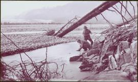 Taku River Survey - Two Men Standing in Shallow River