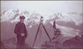 Taku River Survey - Two Men at Flag with Camera